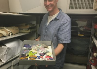 Museum Director, Ernest Dollar, with Collection of Campaign Buttons